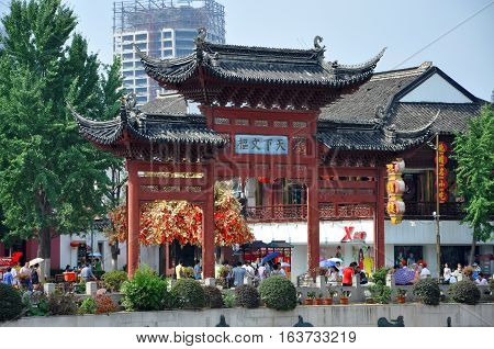 NANJING, CHINA - JUL.5, 2012: Nanjing Confucius Temple, Tian-Xia-Wen-Shu (means the center of national culture) Gateway on the bank of Qinhuai River, Nanjing, Jiangsu, China.