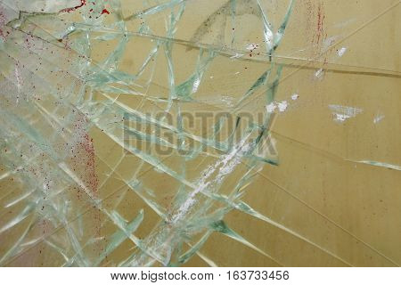 Broken glass and paint on a window