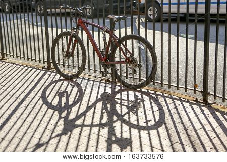 Bicycle chained to a fence in New York City