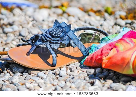 Beautiful Female Flip Flops On The Shore Of The Adriatic Sea.