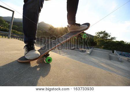 one young skateboarder practice skateboard at skatepark