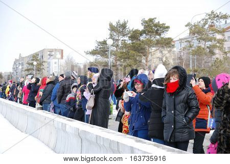 Omsk Russia - 19 March 2016: Spectators watching airshow on the embankment of the river Irtysh in Omsk