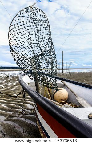 Fisherman boat with the landing net for fishing equipment.