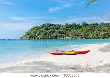 kayaks on the tropical beach with beautiful sky