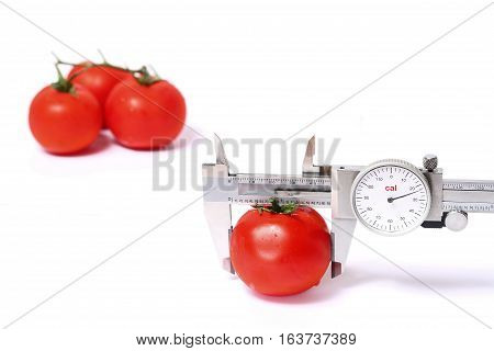 measure to calorie of red tomato at White back ground