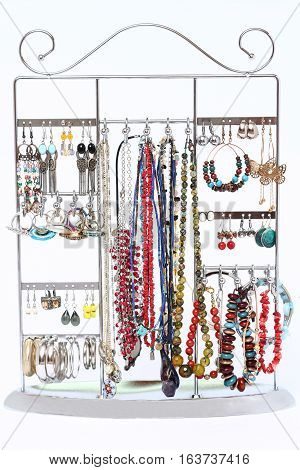 Selection of women's jewellery hanging on a display rack