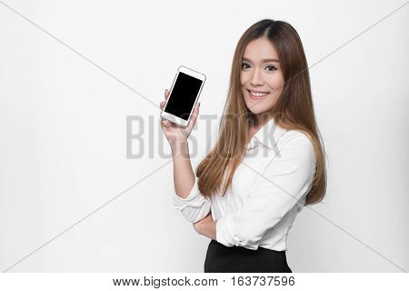Beautiful Asian woman holding blank screen smarthphone on white background