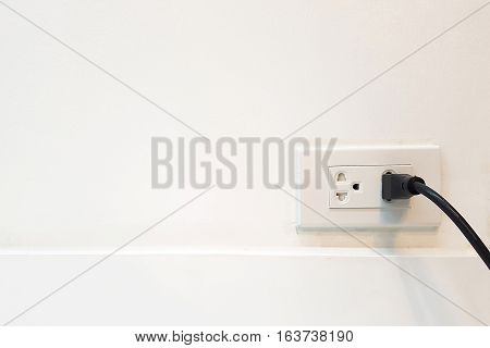 Electric cable in Electrical Outlet with ground wire on the Wall with copy space for label text. Power 250v