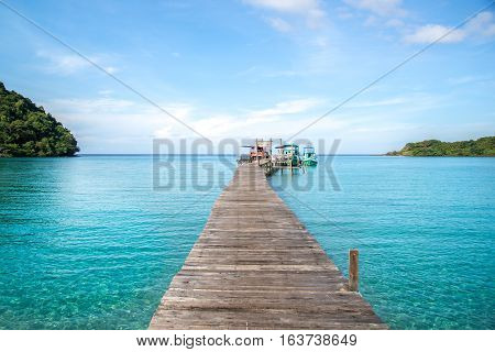 Clear sky and fisher boat habor with wooden bridge