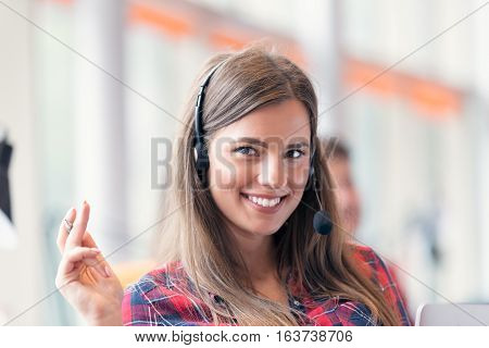 Close up plan of a smiling businesswoman in a call centre.