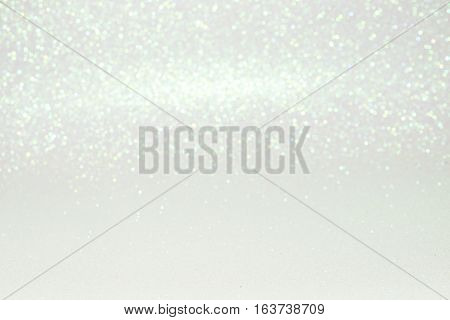Defocused Abstract White Glitter With Bokeh Background