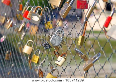 Locks of love hanging on the fence