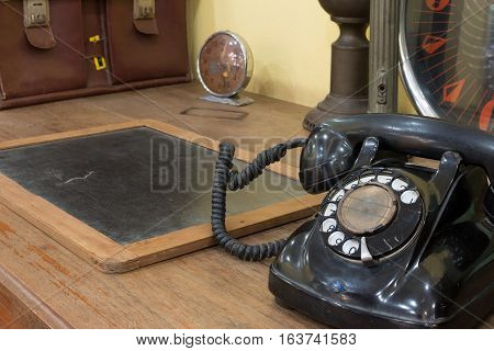 Black Antique Vintage Analog Telephone Dialling Or Scrolling Phone With Antique Clock And Business B