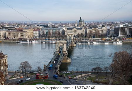 BUDAPEST HUNGARY - DECEMBER 10 2016: Aerial view of Chain Bridge on Danube River and St. Stephen's Basilica. Budapest Hungary