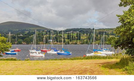 Yachts moored in Ullswater in the Lake District in England.