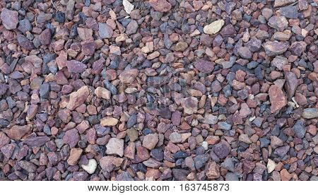 Close-up of red tinted parking lot rocks