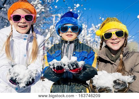 Happy Little Children Playing  In Winter Snow Day.