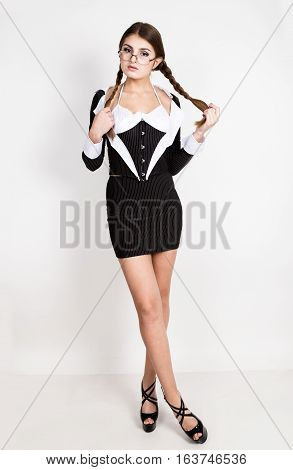 sexy secretary, portrait of beautiful brunette business lady with glasses and wearing in pinstripe suit.