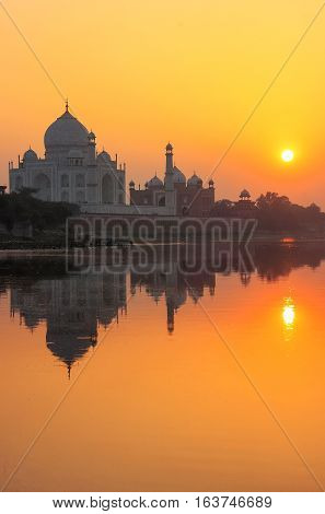 Taj Mahal Reflected In Yamuna River At Sunset In Agra, India