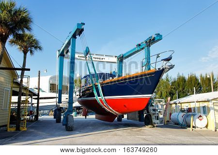 Florida, Usa - March 11: Sailboat In A Sling At Marina Warehouse On March 11, 2014 In Florida, Usa.