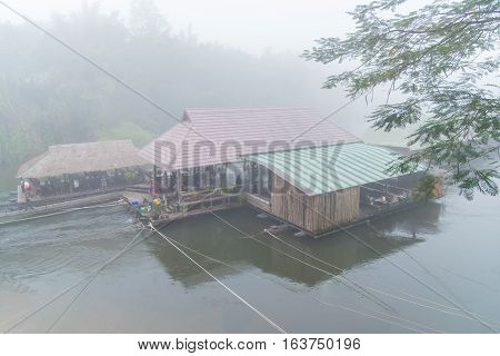 Resort wooden house floating and beautiful mountain fog on river Kwai at Sai yok,Kanchanaburi,Thailand