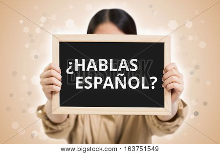 Do You Speak Spanish? (in Spanish) Text On Chalkboard In Child Hands.