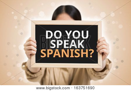 Do You Speak Spanish? Text On Chalkboard In Child Hands.