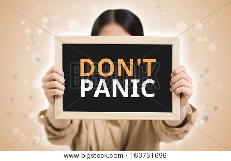 Dont Panic Text On Chalkboard In Child Hands.