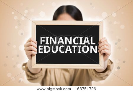 Financial Education Text On Chalkboard In Child Hands.