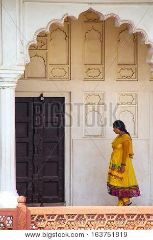 Agra, India - November 7: Unidentified Woman Walks  In Colonnade Walkway Leading To Diwan-i- Khas In