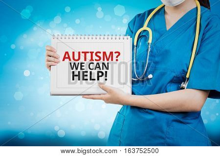 Doctor Shows Autism? We Can Help! Text On White Line Paper Book.