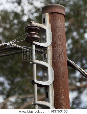Close up of a rusted old electric pole
