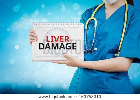 Doctor Shows Liver Damage Text On White Line Paper Book.