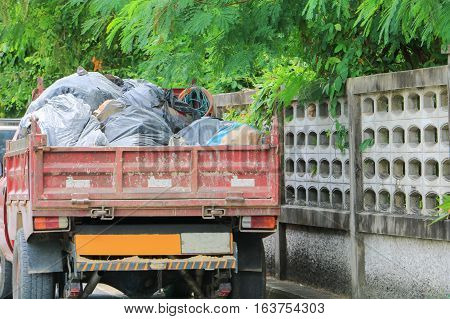 Pile black garbage bag on car truck small