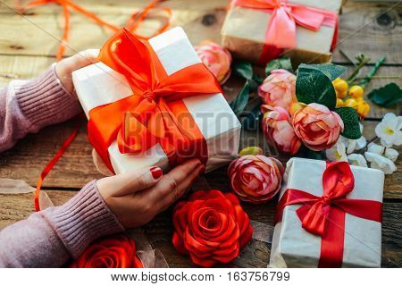 Valentine's Day Concept. Gift With Red Bow  On The Wooden Backg