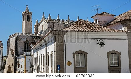Portugal Evora . Stone houses and streets paved with stone in the old city. Bright spring day blue sky.