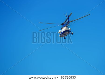 the helicopter is flying blue sky propeller turbine flight rescuer