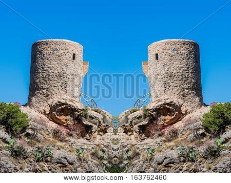 Old signal towers and watchtowers or defensive towers in Spain.