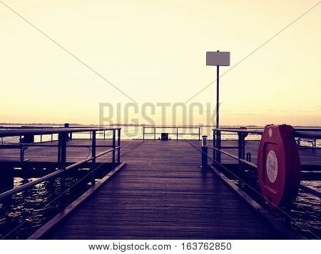 Textured Wooden Terrace By The Sea Shore.  Sea Bridge,