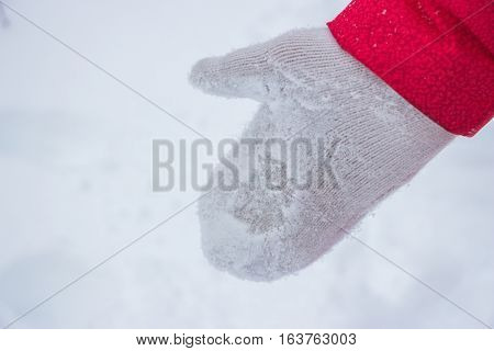 Ivory woman glove in snow in the wood