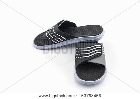Sandals shoes. Black color flip flops on white background.