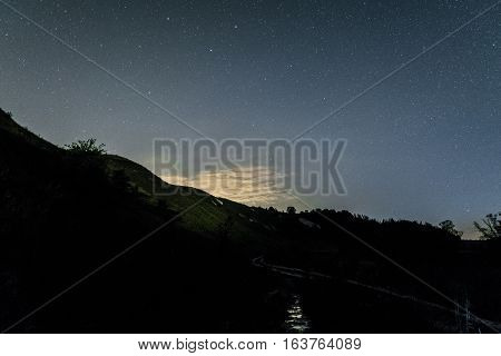 Starry night over the white chalky hills. Night background.