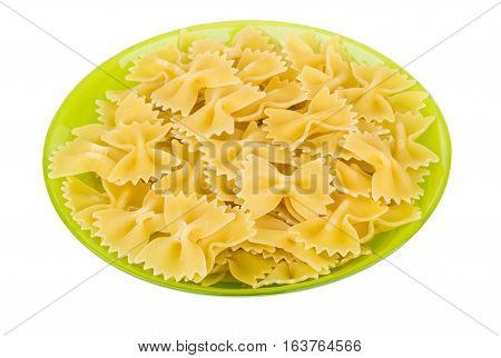 Pasta In Form Of Ribbons In Green Bowl On White