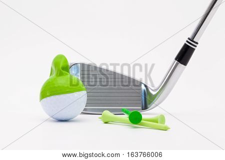 White golf ball with funny cap and golf club on the white background. Funny golf concept.