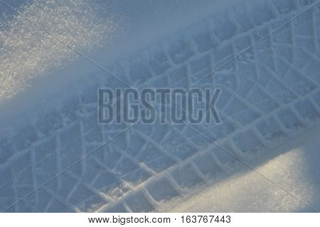 Trace Of The Auto Tire On Snow In The Winter