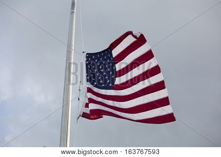 American flag at half mast for mourning and holidays