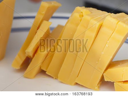 Close up of cheese slices standing like dominoes