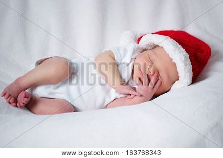 photo of cute newborn baby with santa hat
