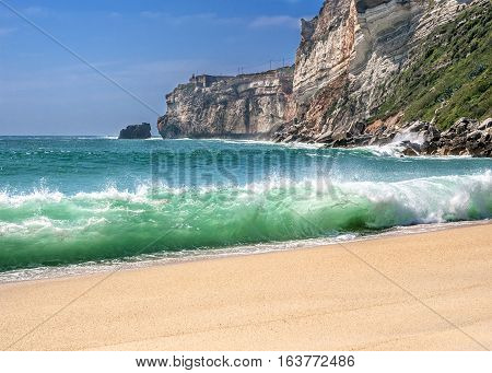 Portugal Costa do Prado . The magnificent sandy beach of the Atlantic Ocean . The sheer high cliffs bordering the beach beautiful surf.