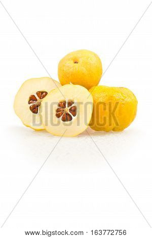 Chaenomeles japonica. Japanese Flowering Quince golden yellow fruits on a white background